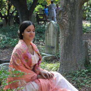Costumed interpreter in cemetery