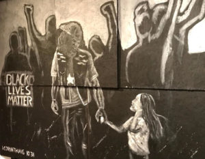 Marching Together Mural - man at protest holds little girls hand