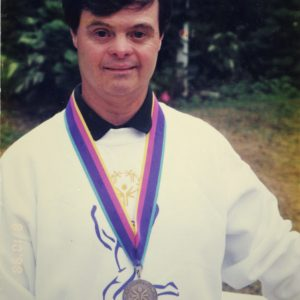 Special Olympian Marty Sheets poses with gold medal